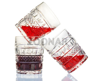 Three crystal wine-glasses and red wine