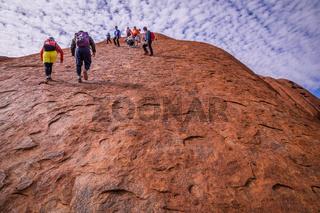 Tourists climbing Uluru Ayers Rock