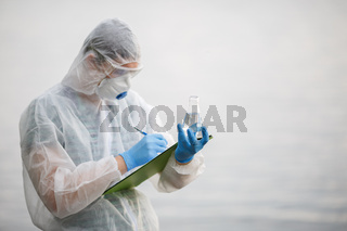 Ecologist writes in folder ,river
