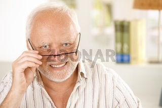 Portrait of happy older man wearing glasses