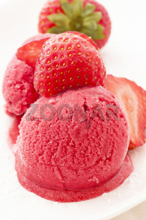 Strawberry ice with strawberries as closeup on a white plate