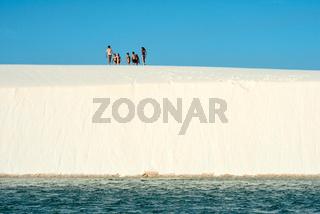 Sand dunes with blue and green lagoons in Lencois Maranhenses National Park, , Brazil