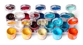 Set of colorful acrylic paints in open jars