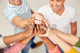 international group of people making high five