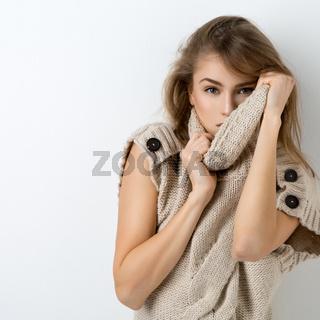 Beautiful girl in long sweater