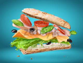 Delicious sandwich with ingredients in the air