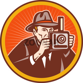 Photographer with hat aiming retro camera