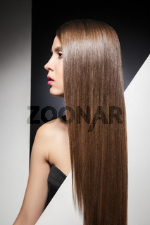 Portrait of long-haired brunette looking away