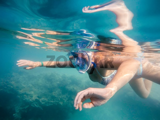 woman snorkel in shallow water