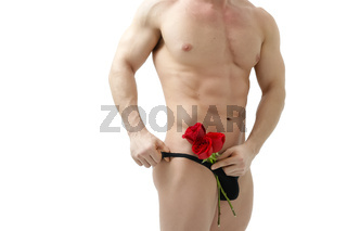 Handsome man holding a red rose and a bouquet of red roses. Sexy man gives a rose on a white background with a beautiful light. Flowers as a romantic gift. Isolated on white background