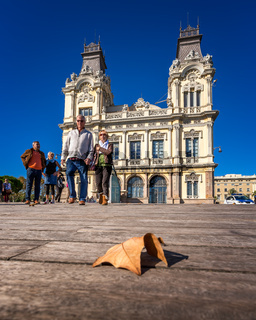 People Walking on Rambla del Mar in front of the Port Vell Building, Barcelona, Catalonia, Spain