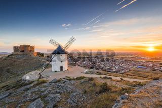 Sun rising over COnsuegra with legendary windmills