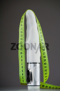 Sex toy and measuring tape