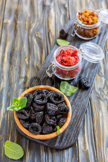 Wooden bowl with prunes.