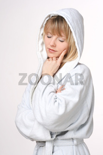 Beautiful Blond Woman In Hooded White Bathrobe