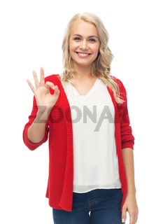 happy smiling young woman showing ok hand sign