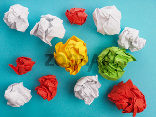 Colorful crumpled paper on blue