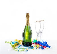 New Year eve party decorations and champagne with drinking glasses on bright background
