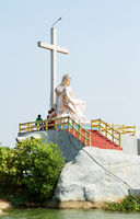 Christian cross and Lamentation of Christ monument in Kerala backwaters