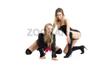 two young show dance girls posing over white