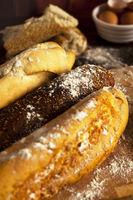 Fresh organic baguettes arranged on cutting board