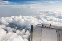 Airliner jet engine and cloudy sky