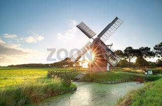 sunshine behind Dutch windmill