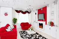Classical living room interior in white and red with fireplace