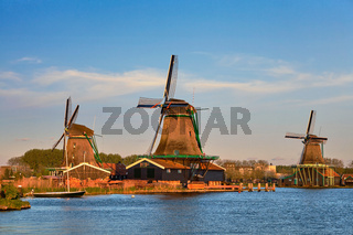 Windmills at Zaanse Schans in Holland in twilight on sunset. Zaa