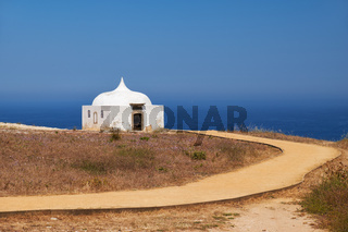 Path near Ermida da Memoria or Memory Chapel of Nossa Senhora do Cabo Church near cape Espichel, Portugal