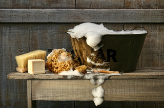 Old wash tub with soap on bench