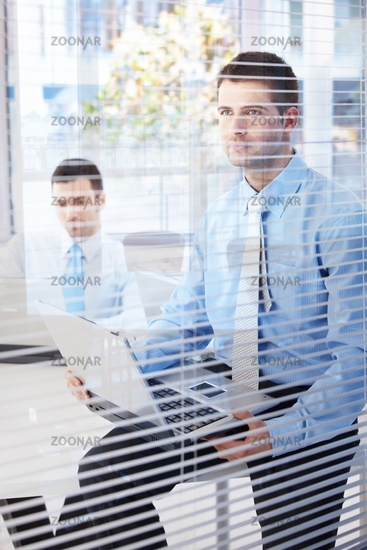 Young businessmen working in bright office