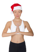 Beautiful asian woman in Santa's hat engaged in fitnes