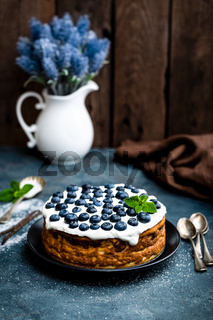 Blueberry cake with fresh berries and whipped cream, cheesecake
