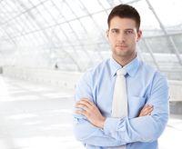 Confident businessman standing at modern passage