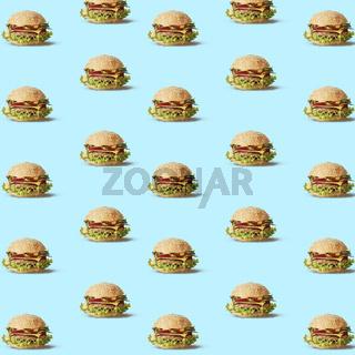 Many tasty fly hamburgers on blue texture.