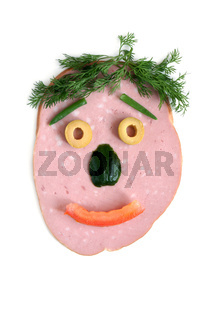 The cut sausage and vegetables in the shape of a happy face