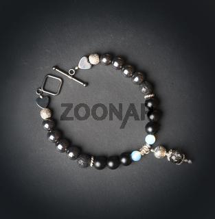 jewel handmade bracelet with semipreciouse stones at black background
