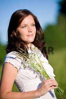 Beautiful woman with daisy flowers