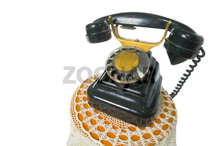 Old antique vintage traditional black phone with disc dials the 19th century isolated on white background  with cliping path. Russia.