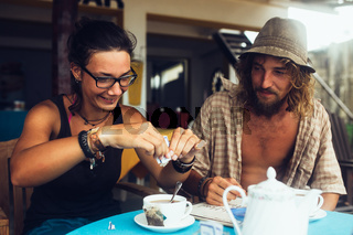 guy and a girl are drinking coffee