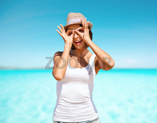 happy young woman in hat over blue sky and sea