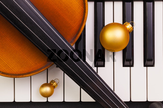 Top view close up shot of piano keyboard,old violin and Christmas decoration.