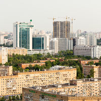 Moscow panoramic view from above, avenues, residential area, construction cranes