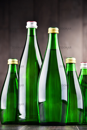 Composition with bottles containing mineral water.