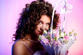 Brunette with a basket of flowers