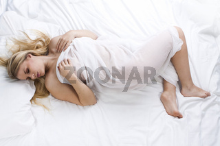 young woman sleeping isolated on white