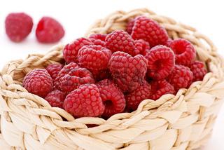 Raspberries as closeup in a basket