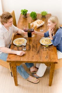 Dinner romantic couple enjoy wine eat pasta