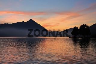 Sunset view from Neuhaus. Mount Niesen and lake Thunersee, Switzerland.